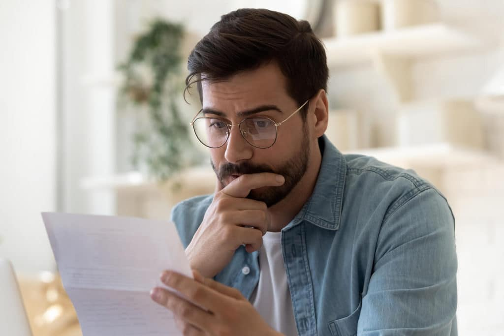 frustrated man reading bad news