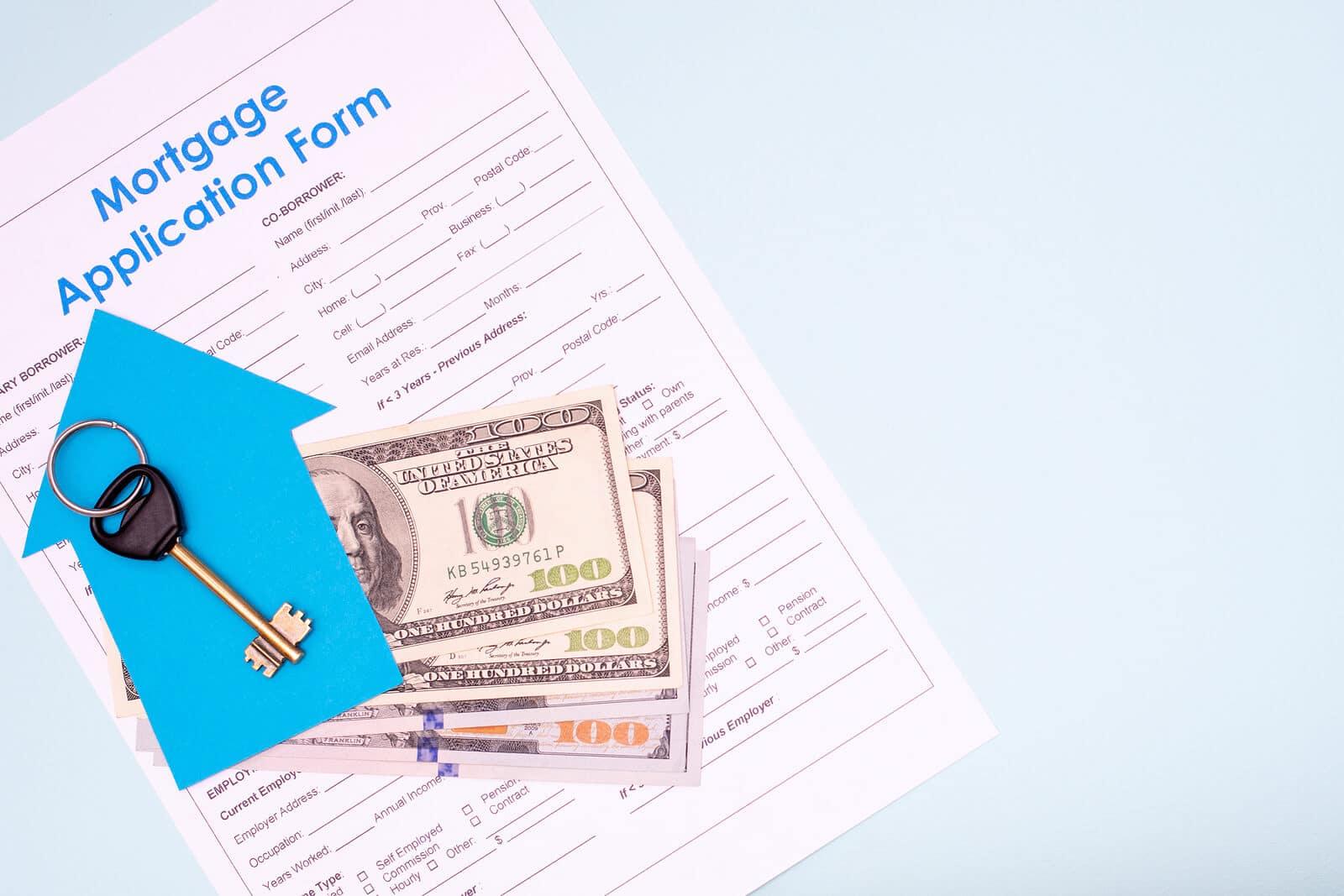 Mortgage application, cash, and keys