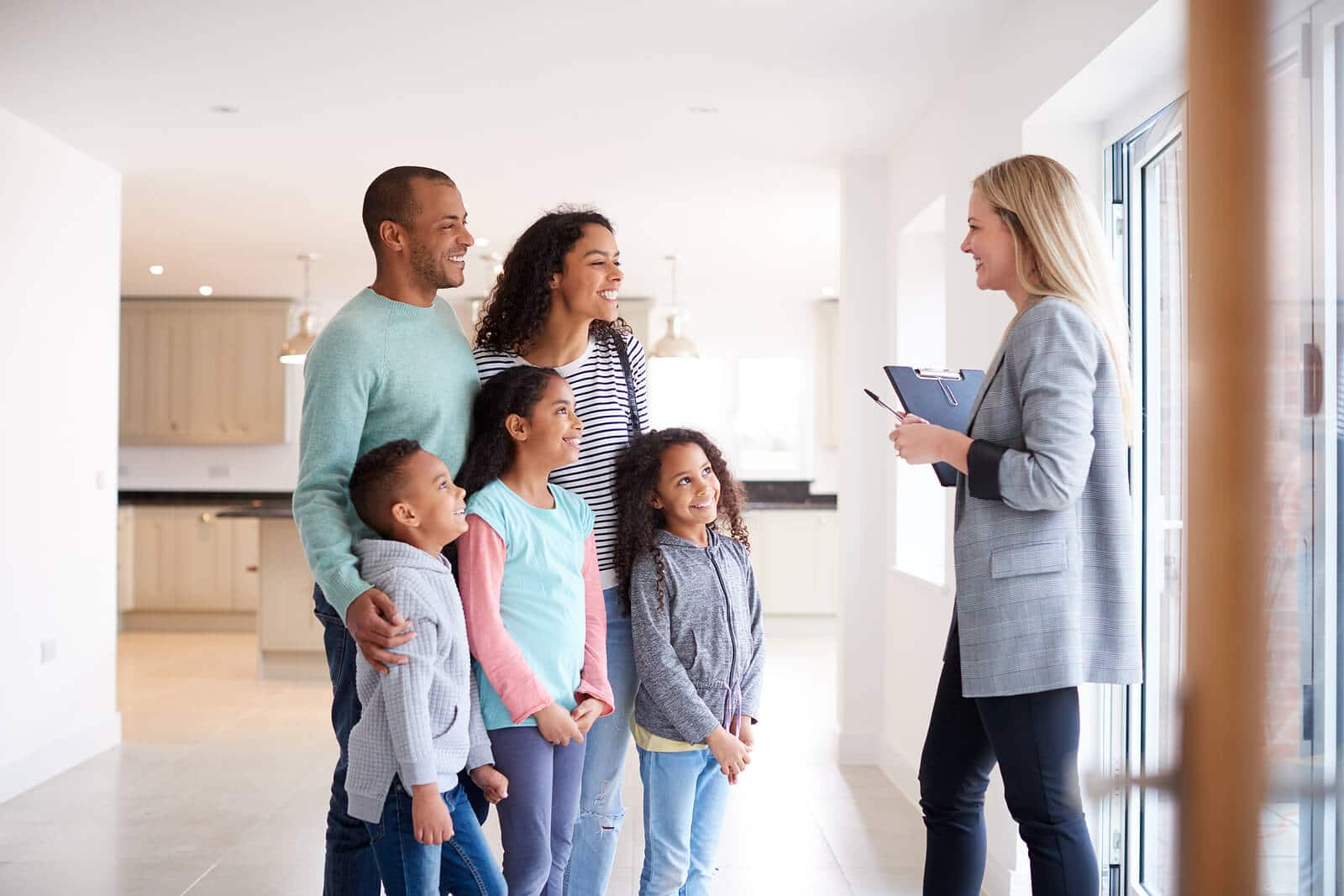 realtor showing a house to a family