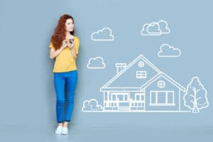 woman thinking of buying a house