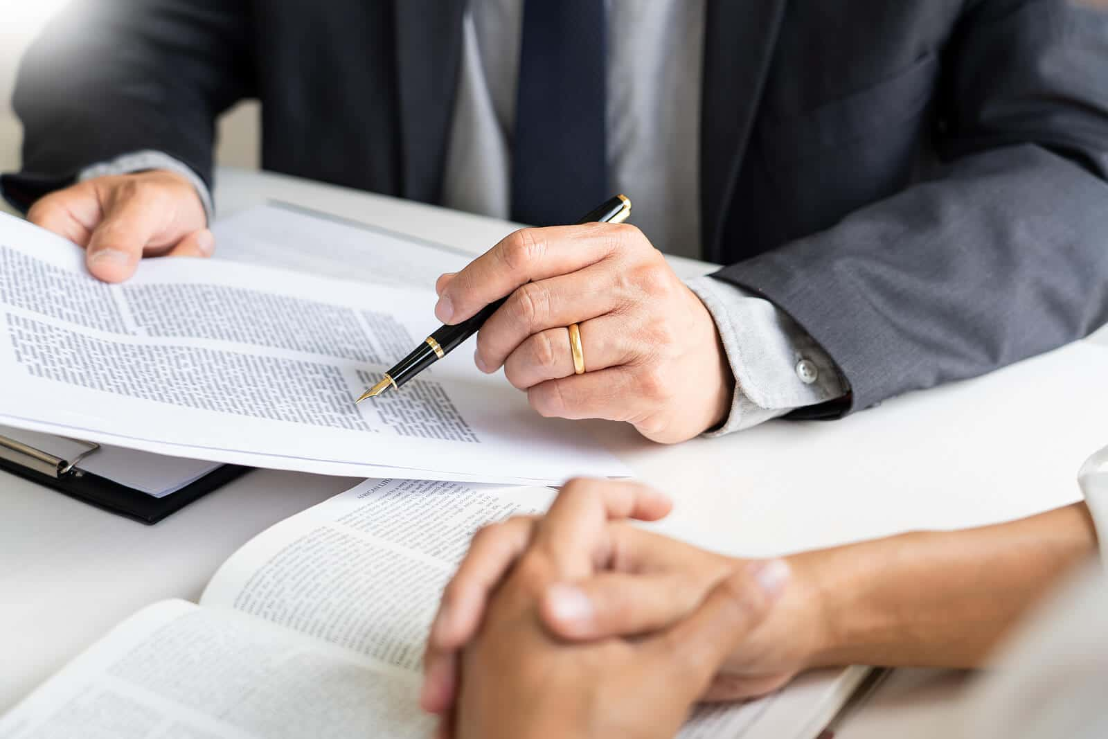 real estate lawyer going over contract terms with a client